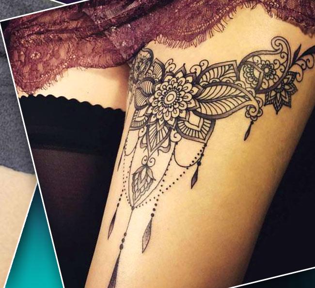 Женская татуировка на бедре подвязка