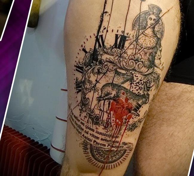 Мужская татуировка на бедре