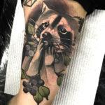 Татуировка енота