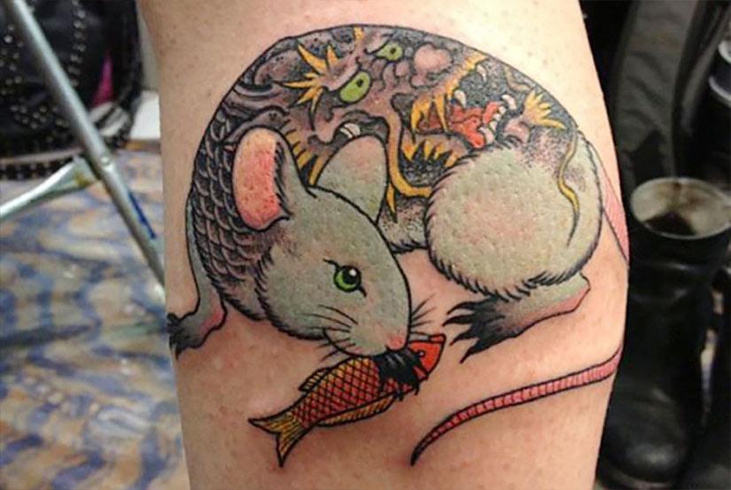 Крыса в виде татуировки по китайскому гороскопу