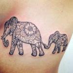 Наколка слонов и узором на теле в виде мандала