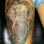 Тату головы слона с цветными орнаментами