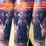 Татуировка слона в стиле реализм на руке