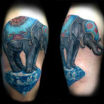 Тату слона стоящего на бриллианте