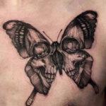 Тату смерть в виде бабочки