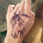 Татуировка с лошадью на руке