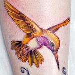 Золотая тату колибри