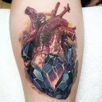 Тату в стиле реализм сердце с кристаллами