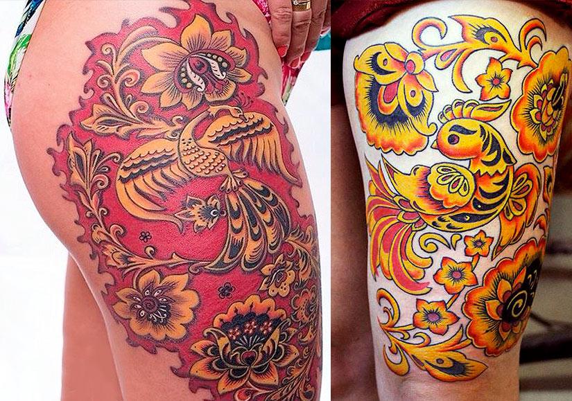 Татуировка с узором хохлома на бедре у девушки