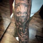 Татуировка девушка в маске